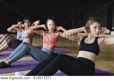 Group Of Asian Beautiful Sexy Athletic Women Performing Sit Up Exercises To Strengthen Their Core Ab