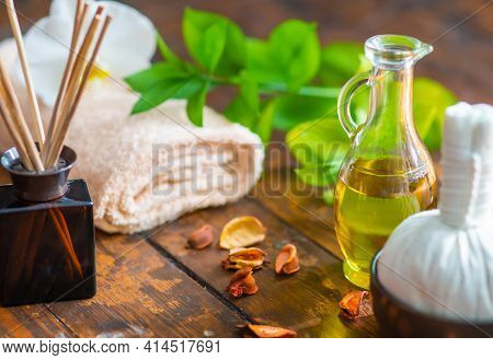 Spa Background. Towel, Candles, Flowers, Aroma Sticks, Massaging Stones And Herbal Balls. Massage, O
