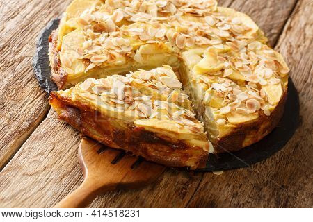 Delicious Invisible Apple Pie With Almond Petals Close-up On A Slate Board On The Table. Horizontal