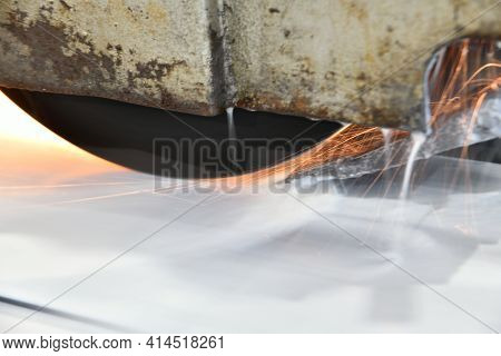 Metal Processing By Grinding On A Surface Grinding Machine With Sparks And Water Cooling.
