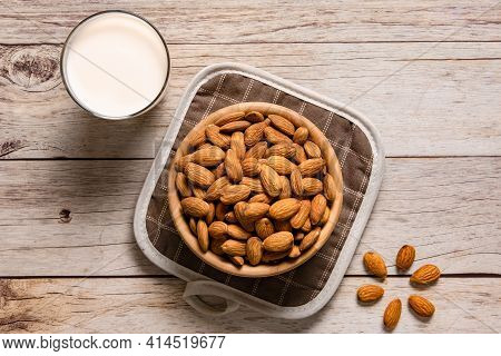 Almond Milk And Almond Seeds Are Plaed On A Wooden Table. Almonds Are Good Fats And High Protein.top