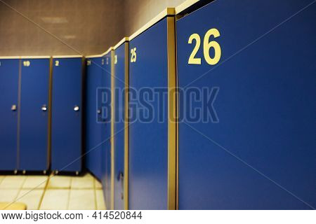 Lockers In The Gym Locker Room. Bench In Front Of The Shower. A Place For Athletes To Change Clothes
