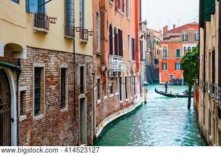 Beautiful Canal With Old Medieval Architecture In Venice, Italy. View Of Grand Canal And Gondola. Fa