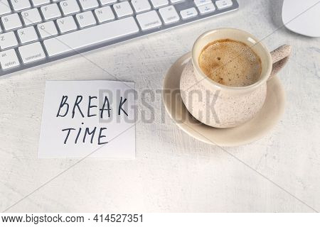 Break Time. Concept Time Off. Words Break Time In Note On The Working Table With Cup Of Coffee And K