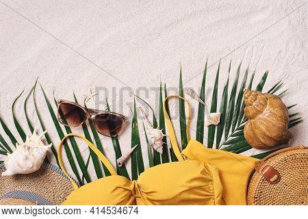 Woman's Beach Accessories: Swimsuit, Bikini, Rattan Bag, Straw Hat, Shells, Sunglasses, Palm Leaves