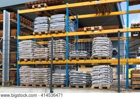 Oldenzaal, Netherlands - March 27, 2021: Outdoor Warehouse Storage Racks For Construction Materials
