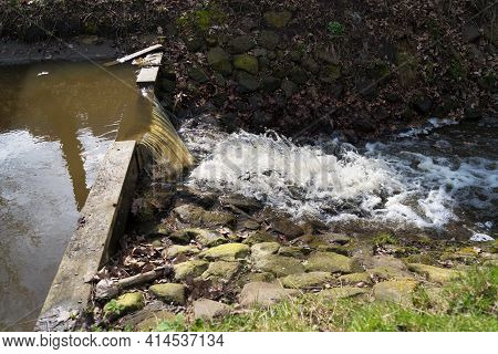 Small Weir In A Ditch In The Netherlands