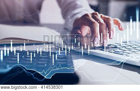 Woman Hands Typing On Keyboard Of Laptop, Calculator With Notebook On Table. Double Exposure Of Fore