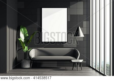 Dark Living Room Interior With A Grey Cosy Sofa, Small Coffee Table And Houseplant. Tiled Wall Is De