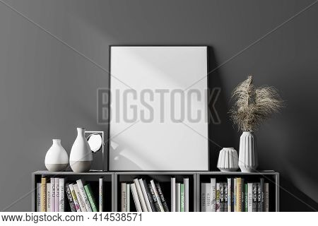 Dark Cosy Interior With An Empty White Poster, Vases And Mirror Located Above A Long Bookshelf. In T