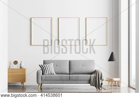 Bright Modern Living Room Interior With Three Empty Posters In A Row On The White Wall, Comfortable