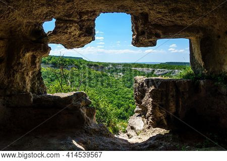 Cross-like Window Inside Artificial Caves Of Ancient City Chufut-kale, Bakhchisaray, Crimea. Caves W