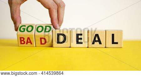 Good Or Bad Deal Symbol. Businessman Turns Wooden Cubes And Changes Words 'bad Deal' To 'good Deal'.