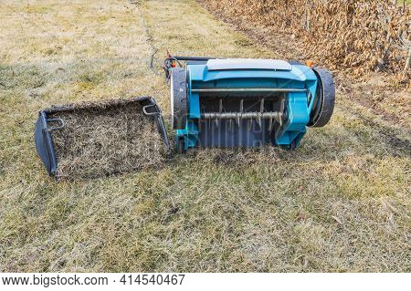 Preparing The Lawn For Summer With An Electric Aerator In Early Spring. Garden Machines Concept. Swe