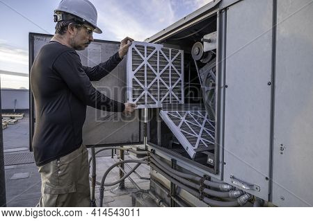 Hvac Mechanic Doing An Air Filter Change On A Commercial Make Up Air Unit