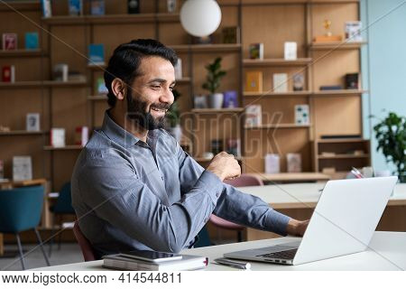 Happy Indian Professional Young Adult Man Having Video Conference Call Virtual Business Meeting Work