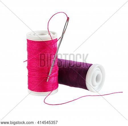 Spool Of Thread With Needle Isolated On White Background. Sewing Thread And Needle.