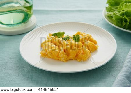 Scrambled Eggs, Omelette. Breakfast With Pan-fried Eggs. Texture Of Omelet On White Plate