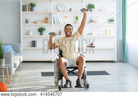 Physical Activities For Disabled People. Handicapped Man In Wheelchair Making Rehabilitation Exerise