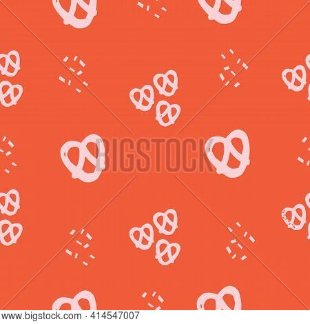 Seamless Repeat Pretzel Pattern With Pink Pretzels And A Red Background