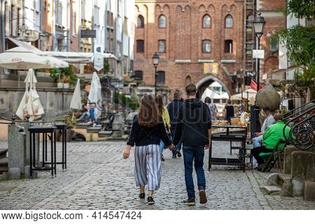 Gdansk, Poland - Sept 9, 2020: Group Of People On Mariacka Street, The Main Shopping Street For The