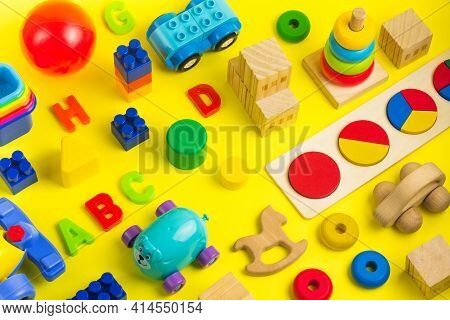 Plastic And Wooden Colorful Toys Blocks, Car, Letters And Bricks. Activity For Kids In Day Care And