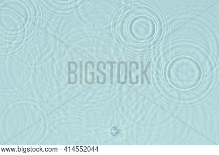Water Background. Blue Water Texture, Blue Mint Water Surface With Rings And Ripple. Spa Concept Bac