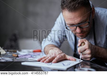 Lithograph Professional Artist Handmade Worker. Bearded Middle Aged Man In Apron And Glasses Making