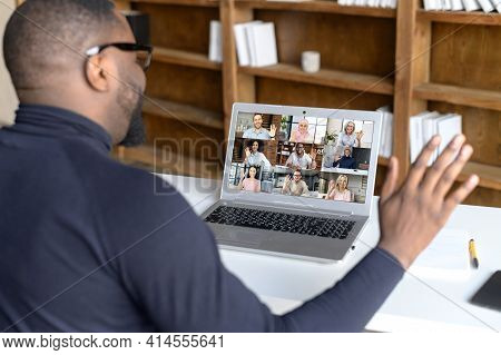 Back View Of African Businessman Talk With Co-workers Partners Using Video Call On Laptop, Discuss W