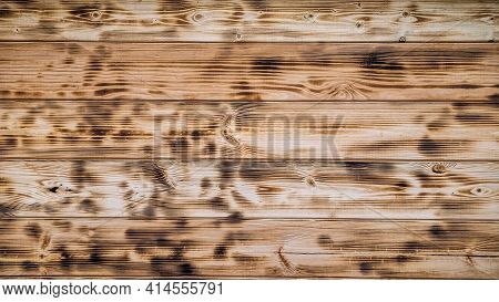Light Wood Texture. Charred And Burnt Old Boards With Knots. Close-up Texture Of Wide Burnt Board, P