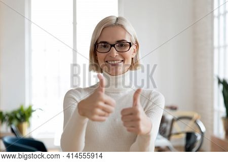 Portrait Of Smiling Female Show Thumb Up Giving Recommendation