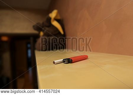 A Cigarette And A Lighter Are On The Top Shelf. Smokers Stash
