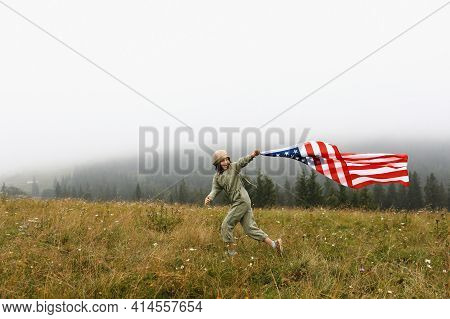 Happy Adorable Little Girl Smiling And Waving American Flag. Patriotic Holiday. Happy Kid, Cute Litt