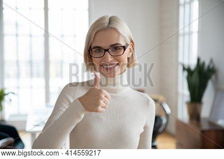 Portrait Of Smiling Caucasian Woman Recommend Good Service