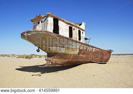 Abandoned Ship At Ship Graveyard In Mo'ynoq Uzbekistan