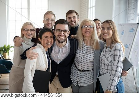 Portrait Of Overjoyed Multiracial Colleagues Pose Together In Office