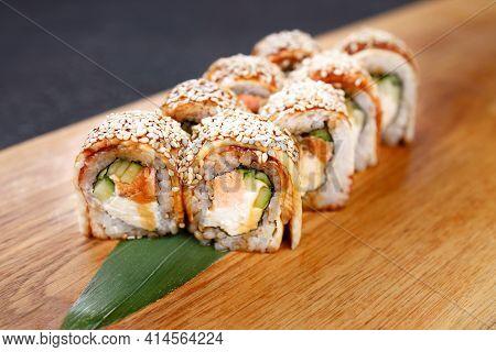 Eel Unagi Maki Sushi Rolls On Serving Board
