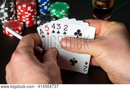 Poker Cards With High Card Combination. Close Up Of A Gambler Hands Is Holding Playing Cards In Poke