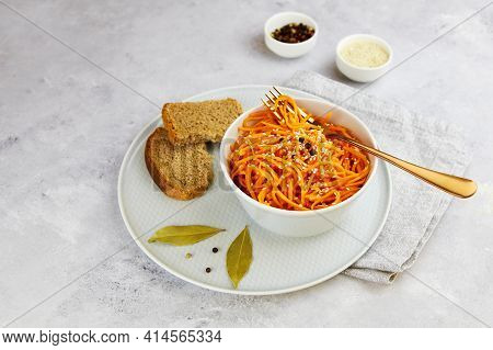 Korean Spicy Carrot Salad, Grated Raw Carrots In A Bowl On A Grey Background.