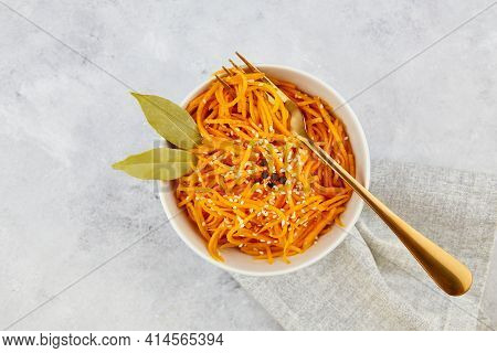 Spicy Pickled Carrots In A Bowl On A Grey Background, Spicy Korean Appetizer. Vegan Healthy Food. Cl