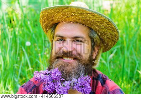 Spring. Smiling Bearded Man With Flowers In Beard. Hipster Beard With Flowers. Barber Shop Advertisi