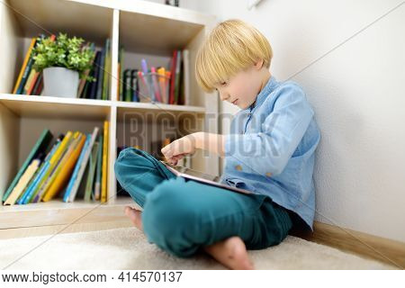 Preschooler Boy Watches Cartoon Movie By Tablet Or Playing Pc Game. Overuse And Addiction Kids From