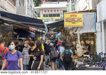 Hong Kong, China - November 05, 2020 : Tourist In The Market Street In Tai O. Tai O Is A Popular Tra