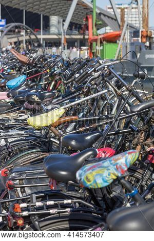 Amsterdam, Netherlands - July 02, 2018: Parking For Bicycles On The Embankment Of Amsterdam