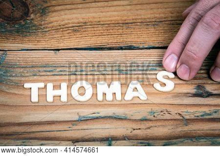 Thomas. Name Of Men And Boys. Birthday Concept. White Letters Of The Alphabet On A Wooden Background