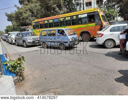 Closeup Of Private Bus And Group Of Cars Waiting In A Traffic Jam At Bangalore During Mid Day At Sum