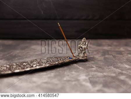 Incense Stick Burning On A Metal Stand. Indian Incense Sticks Smoke In A Stand On Gray Background. C