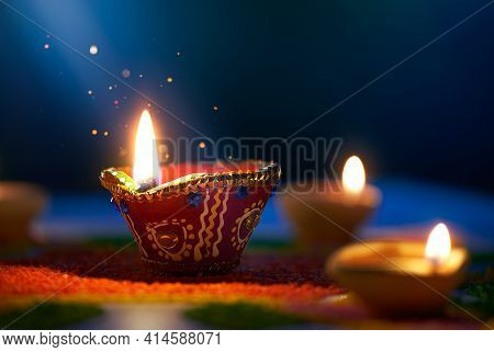 Happy Diwali, Moonlight Shining On A Lit Diya Lamp