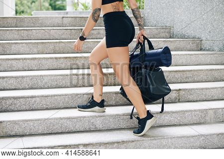 Cropped Image Of Fit Young Woman With Gym Bag Walking Up The Stairs