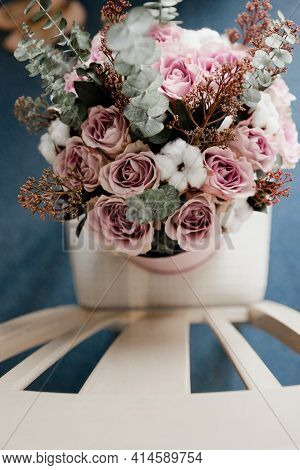 Beautiful Wedding Bridal Bouquet Close Up. Flowers Standing On A Chair. A Bouquet Of Flowers In A Ca